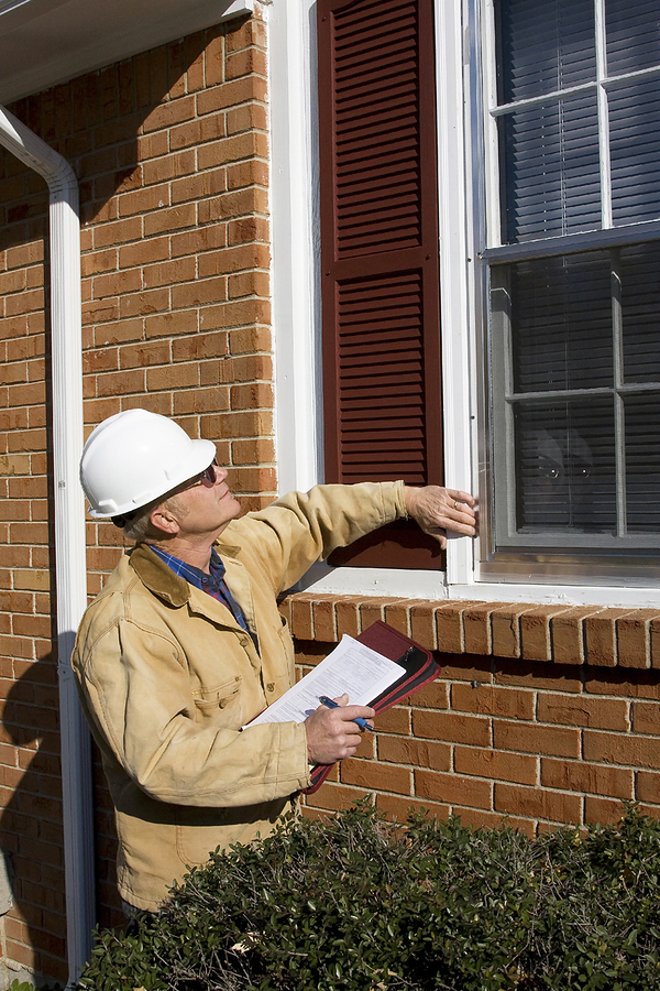 Home inspector completing a home inspection report