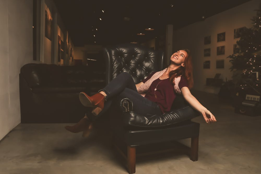 woman sitting comfortably in  leather lounges in Melbourne