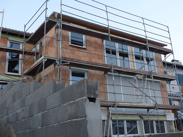 scaffold surrounding a home for construction