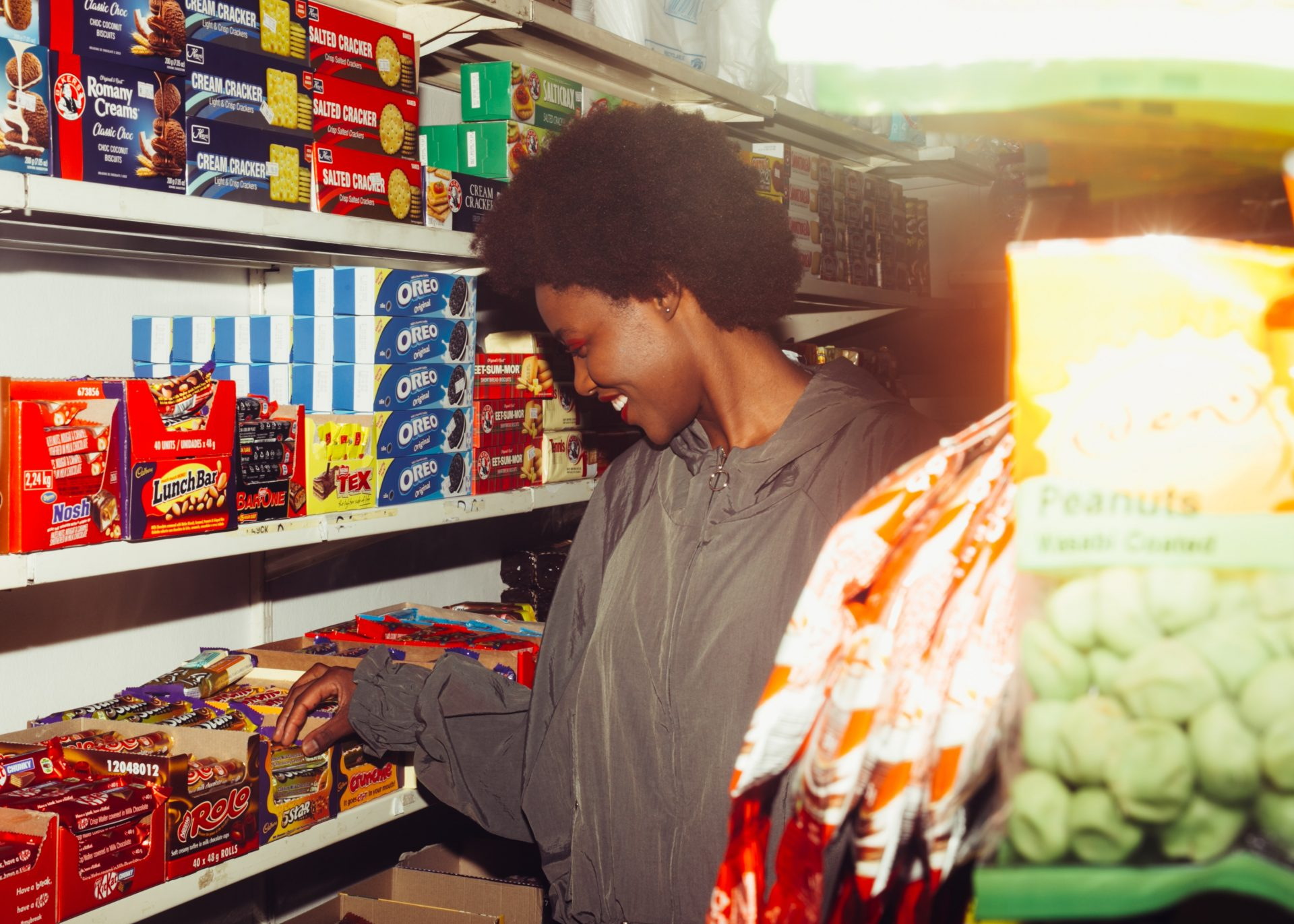 Woman checking British candies in a convenience store